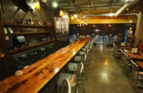 Industrial metal and high-gloss raw wood make for a striking design at Manito Taphouse.
